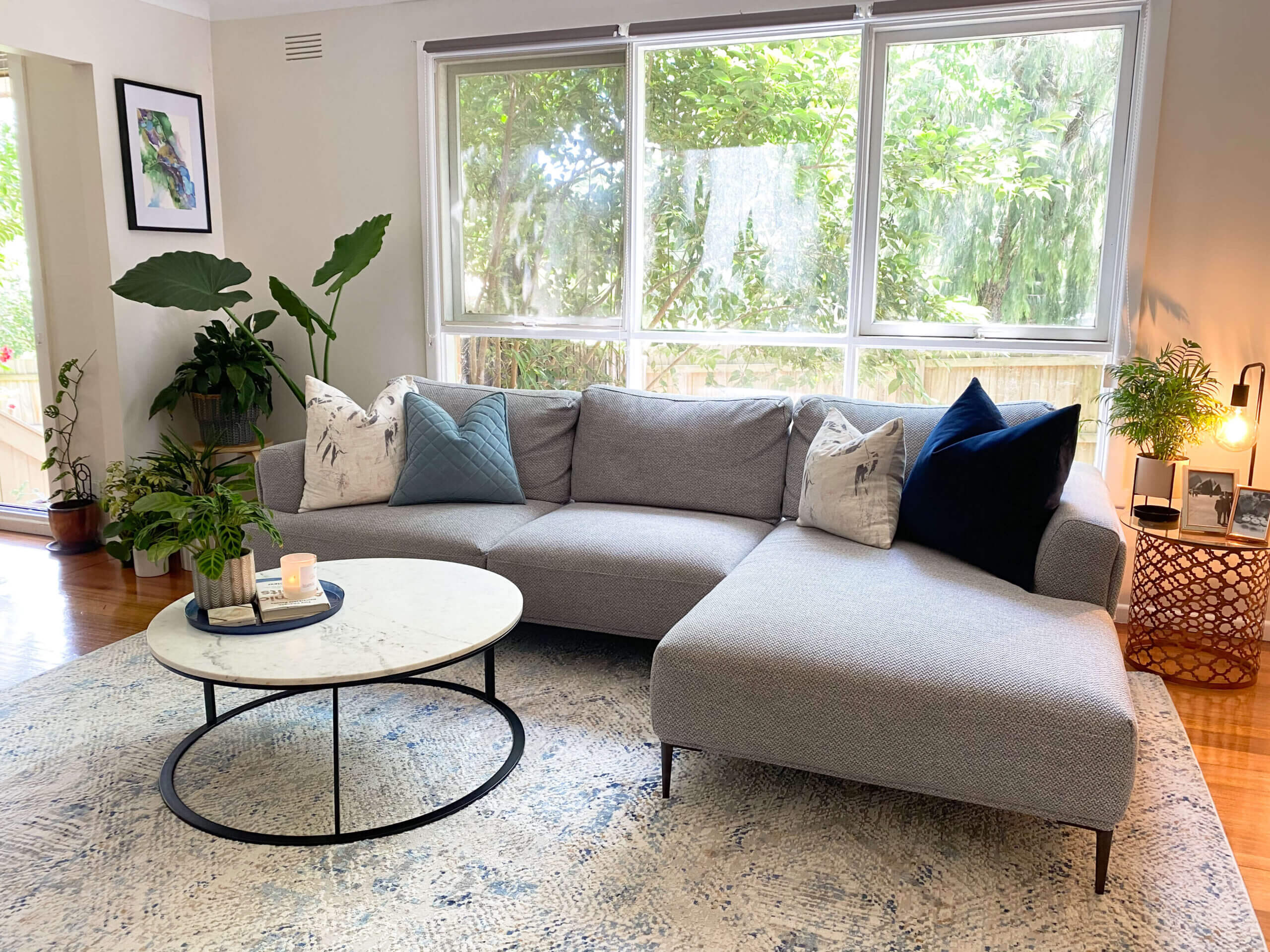 Style your living room with plants and natural lighting.