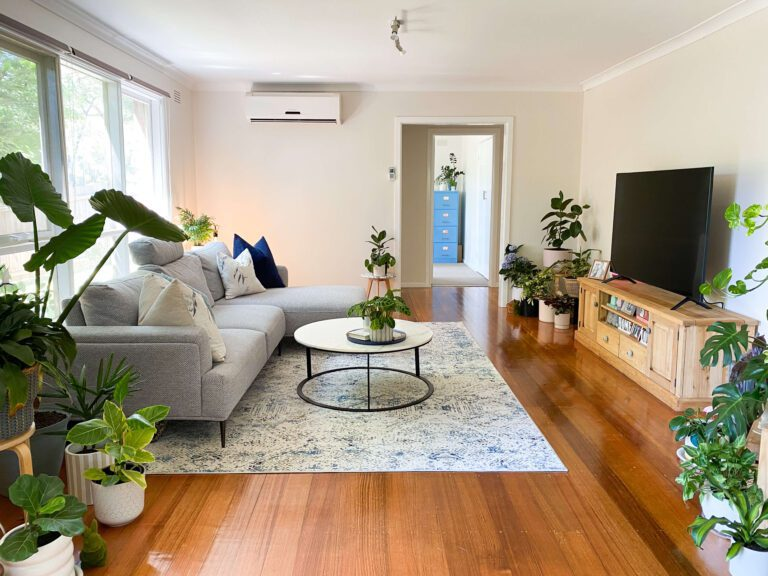 living room with lots of natural light and green plants