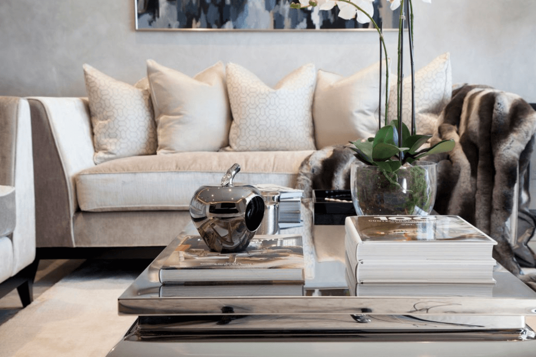 Luxurious styling with grand coffee table and cream sofa with feather cushions