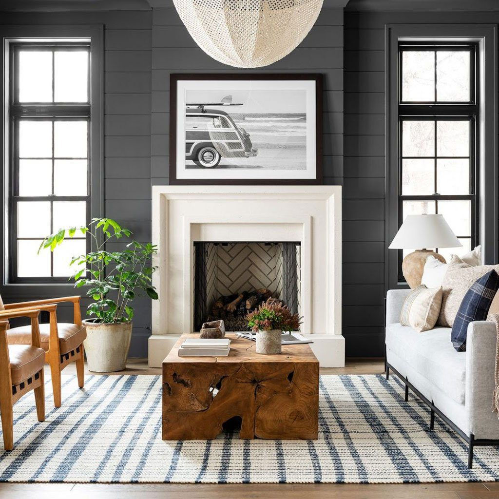 contemporary living room dark feature wall and white fireplace