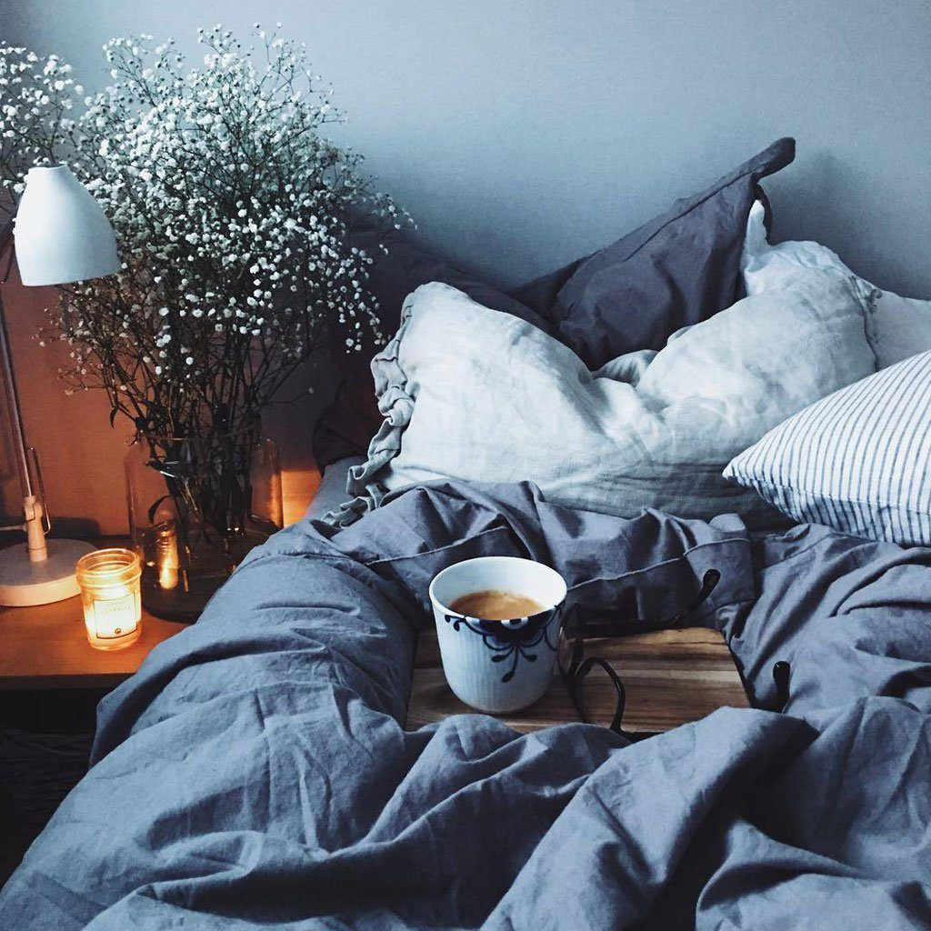 cosy bedding with cup of tea
