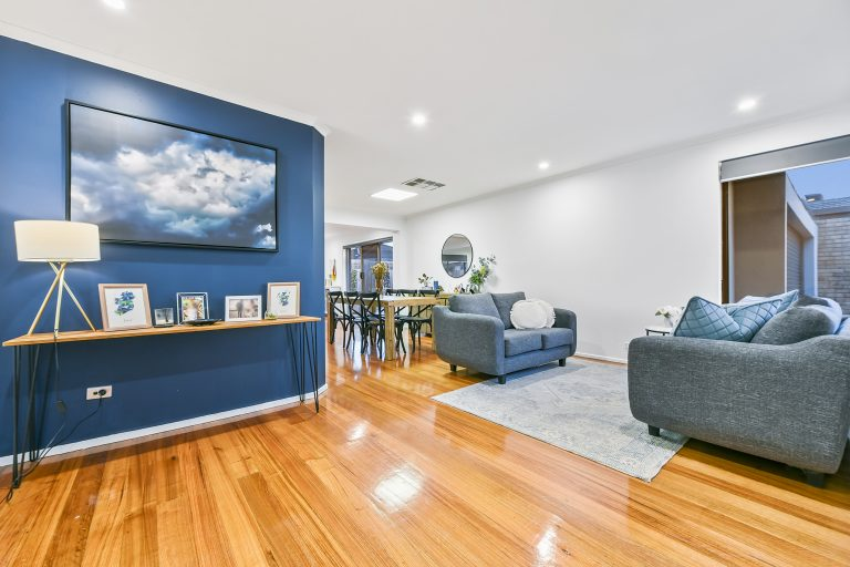 living room design with feature blue wall and cloud art