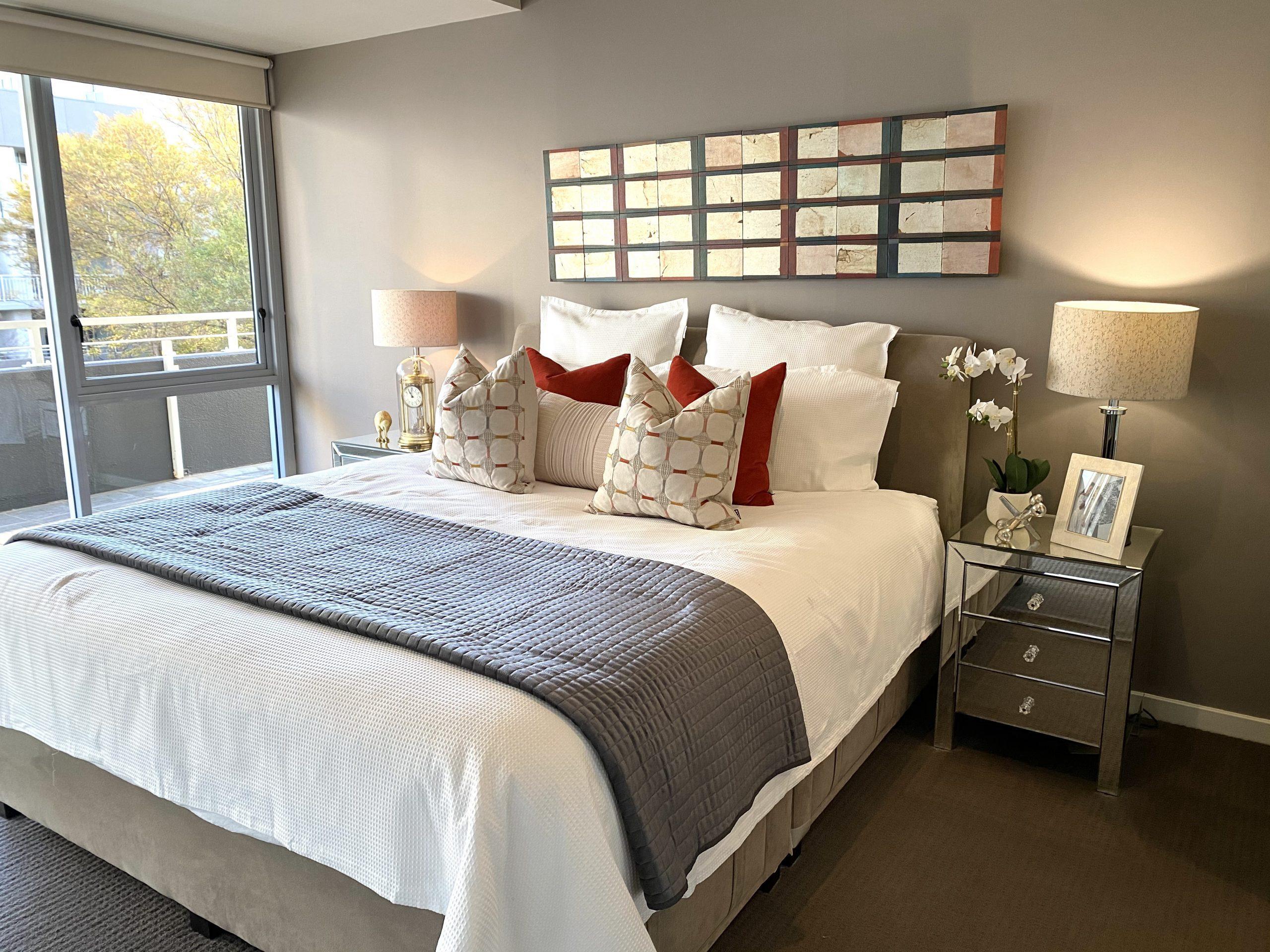 master bedroom design with burnt orange and mirror bedsides