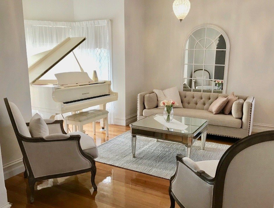 French Provincial living room with white grand piano