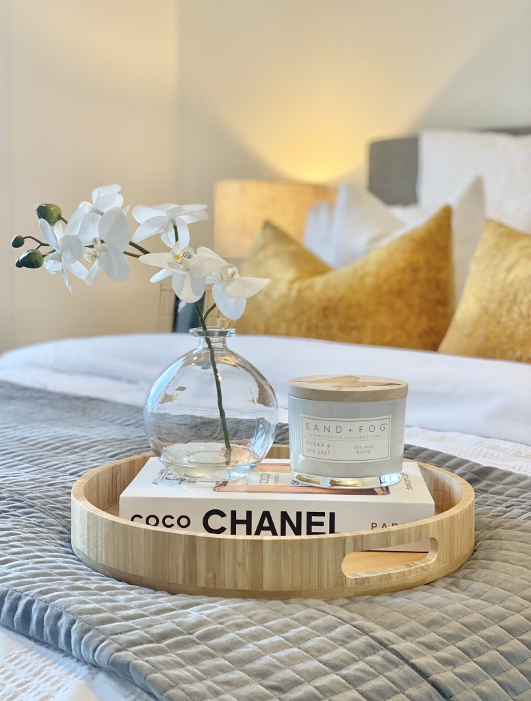 decorative tray on a bed for styling