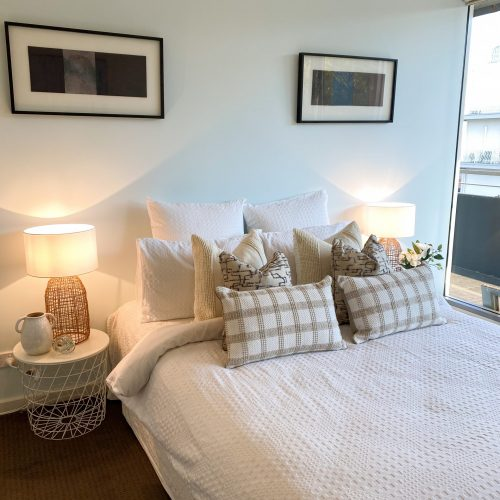 cushions with mixed patterns for bedroom styling