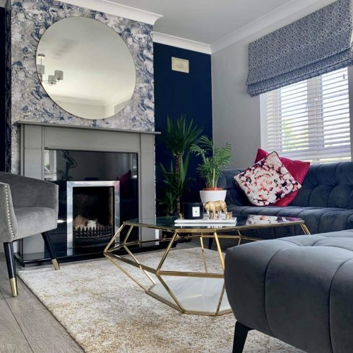 grey fireplace with round mirror above